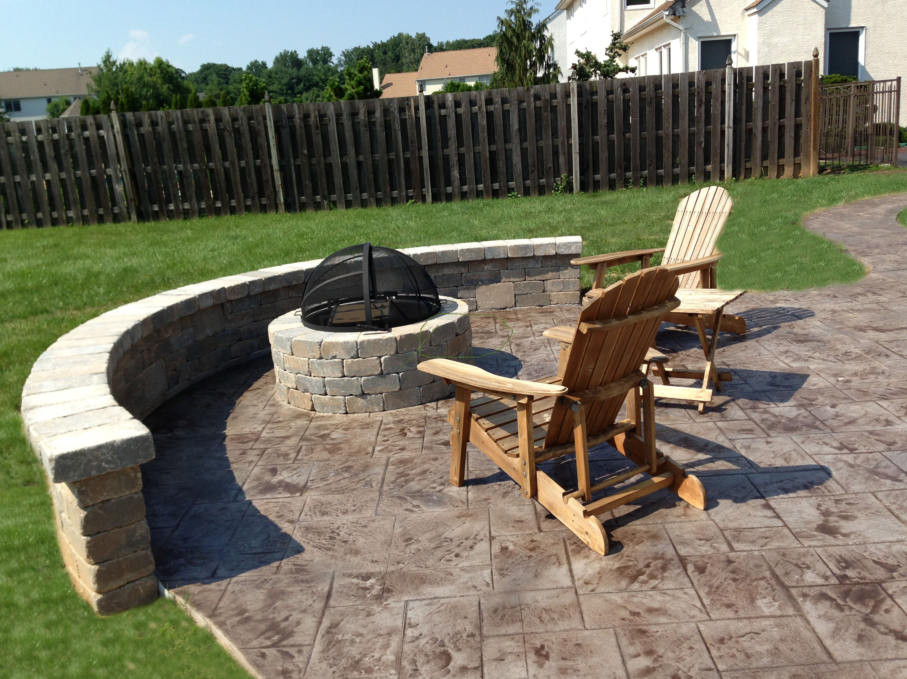 Stamped Concrete Patio With Sitting Wall And Fire Pit